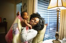 Jasmine Johnson, with 10-month-old daughter Rain, lost her health coverage and was told she could not re-enroll, even though federal law allows former foster children to stay in Medicaid until they turn 26.