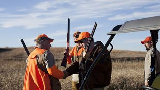 Rep. Steve King, R-Iowa, greets Sen. Ted Cruz at King's annual pheasant hunt at the Hole N' the Wall Lodge in Akron, Iowa on Saturday, October 31, 2015.