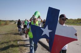 Immigrants and activists begin a 37-mile march to Austin on Nov. 19, 2015 to show their support for immigration reform. The marchers planned to walk for three days, from the federal immigration detention facility in Taylor to the Texas Governor's Mansion in downtown Austin.