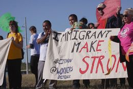 Immigrants and activists participate in press conference and rally on Nov. 19, 2015, before a 37-mile march designed to show support for immigration reform. The marchers planned to walk for three days, from the federal immigration detention facility in Taylor to the Texas Governor's Mansion in downtown Austin.
