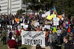 Group gathers at Wooldridge Park in Austin to protest Gov. Abbott's decision not to accept any refugees from Syria