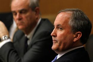 Texas Attorney General Ken Paxton, right, looks at one of the special prosecutors during a pre-trial motion hearing at the Collin County Courthouse on Tuesday, Dec. 1, 2015, in McKinney, Texas.