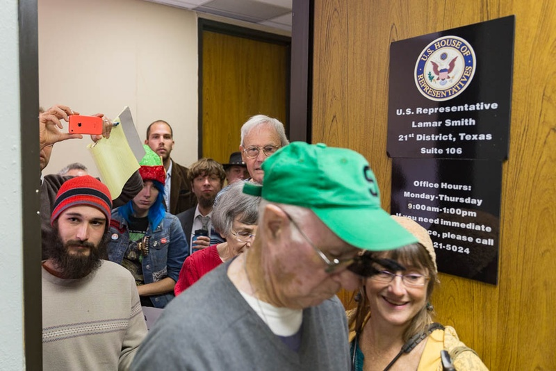"Climate change activists crowd Representative Lamar Smith's office to present him with the ""Flat Earth Foundation of Texas"" Award for ""Semi Skeptic"" of Distinction on Dec. 7th, 2015. Photo by: Shelby Knowles"
