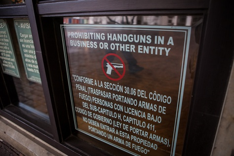 An open carry sign posted at the entrance to the DoubleTree Hotel in Austin on Dec. 21, 2015.