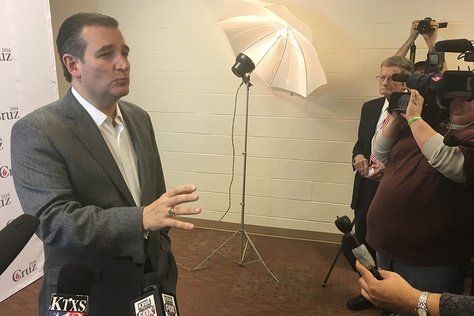 Presidential contender Ted Cruz speaks to the press in Cisco, Texas on Dec. 29, 2015.