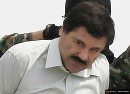 "Joaquin ""El Chapo"" Guzman is escorted in a presentation at the Navy's airstrip in Mexico City on Feb. 22, 2014."