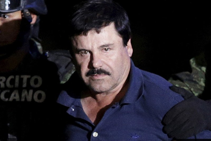 "Captured fugitive drug cartel leader Joaquin ""El Chapo"" Guzman is escorted by police in Mexico City on Jan. 8, 2016."