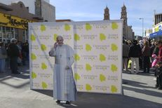 A cardboard cutout of His Holiness Pope Francis  greets residents of Ciudad Juárez on January 16, 2016. Pope Francis will visit the border city in February as part of a six-day tour of Mexico.