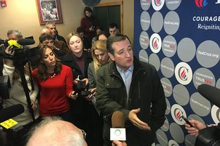 Presidential candidate Ted Cruz talks to the press in Manchester, Iowa on Monday, Jan. 25, 2016.