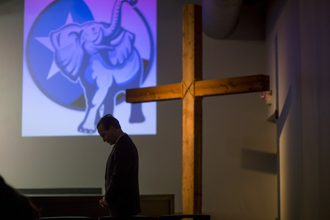 """Jared Woodfill prays at a """"Take Back Our Party"""" event  in Spring on Jan. 26, 2016. Woodfill, who is running for Texas Republican party chairman, started the series of events to to """"take back"""" the Republican party from what they see as the more moderate establishment."""