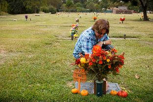 Dan Golvach, father of Spencer Golvach,  at his son's grave in Houston Tuesday, October 20, 2015.