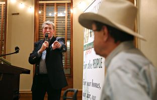 Lon Burnam, a candidate for Texas Railroad Commision, thanks Jim Hightower at his campaign kickoff at the Scholz Garden on Thursday, January 28.