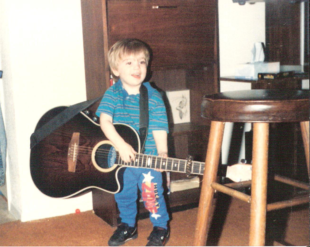 Spencer Golvach, at the age of three, pictured with a guitar. Authorities say Golvach was killed by Victor Reyes, an undocumented immigrant, during a random shooting spree in January 2015.