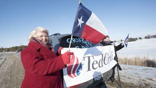 Melody Perez (left) of San Antonio and her daughter waited for the arrival of Ted Cruz's campaign bus in Emmetsburg, Iowa, during a campaign stop on Jan. 29, 2016.