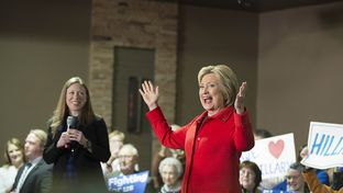 Hillary Clinton cheers as she acknowledges the crowd in Carroll, Iowa with daughter Chelsea on Jan. 30, 2016.