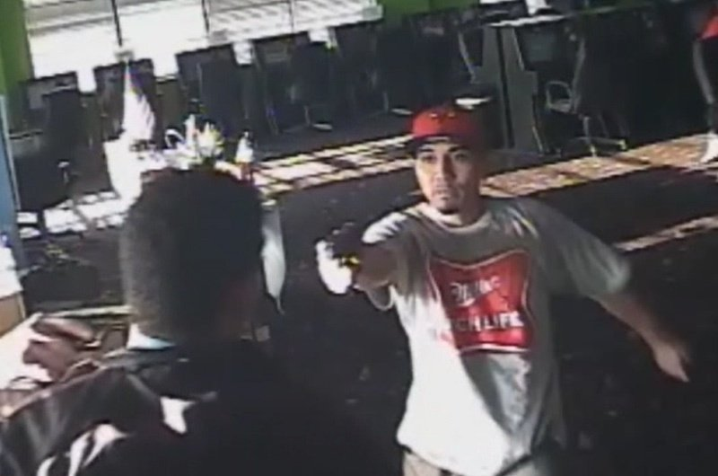 Obed Josafhat Rodriguez is pictured waving a gun on surveillance video taken from the Monroe Game Room in Houston on Aug. 30, 2013. He and an accomplice were convicted in shooting death of Yolanda Lara, a game room employee.