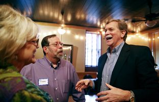 Chris and Bill Rosenburg talk with Texas Railroad Commision candidate Lon Burnam at his campaign kickoff at the Scholz Garden.