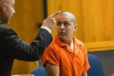 Ex-Border Patrol agent Joel Luna confers with attorney Carlos Garcia after his arraignment in Brownsville before Judge Benjamin Euresti on Feb. 3, 2016.