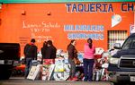 Shopers at a makeshift sale in front of aclosed taqueria on the eastside of  Houston Wednesday, February 3, 2016. Draw in 1991 to reflect the area's booming Hispanic population, the Houston-based 29th Congressional District has never had a Hispanic representative.(Photo by Michael Stravato)