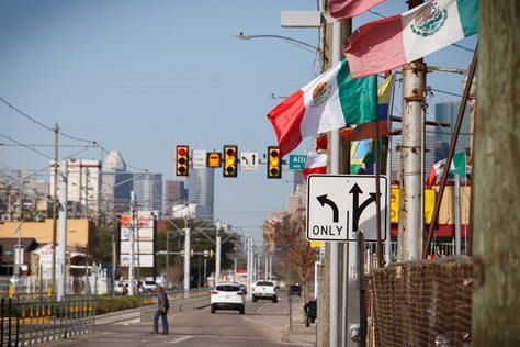 Mexican flags wave along Harrisburg Ave. in Houston. Drawn in 1991 to reflect the area's booming Hispanic population, the Houston-based 29th Congressional District has never had a Hispanic representative.
