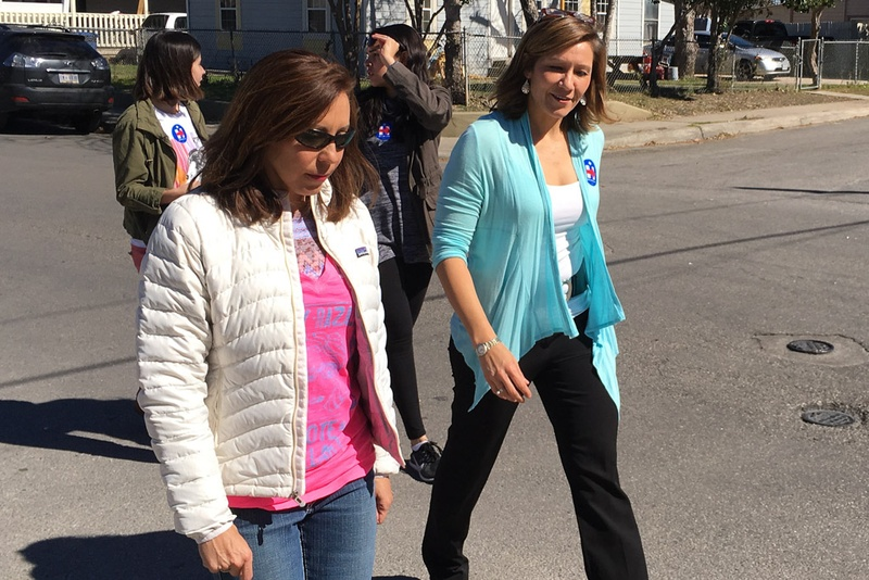 Hillary Clinton's national political director Amanda Renteria (right) canvasses neighborhoods in San Antonio on Feb. 8, 2016.