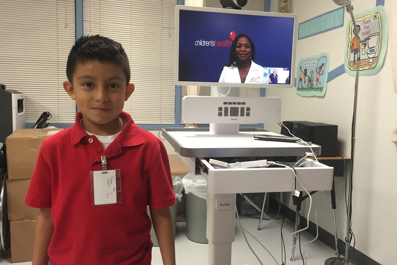 Second grader Diego Montealvo visits the school nurse's office for a virtual checkup with Dr. Stormee Williams, a pediatrician with Children's Medical Center of Dallas.