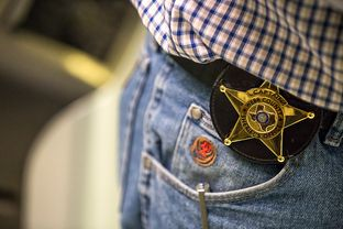 The badge of Captain Jaime Magaña in Webb County Jail in Laredo, TX, on Nov. 5, 2015. Photo by Martin do Nascimento
