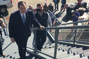 U.S. Sen. and GOP presidential hopeful Ted Cruz boards the decommissioned battleship USS Yorktown in Mount Pleasant, South Carolina, to deliver a speech on foreign policy on Feb. 16, 2016.
