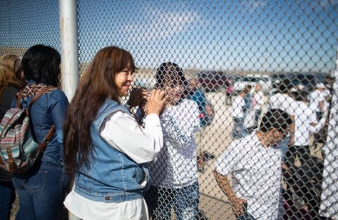 Maria Guadalupe Perez of Juarez holds the hand of her daughter through the border fence in Juarez, Monday, February 15, 2016. Perez has not seen her daughter, Linda Rodriguez, since she was 6 months old.