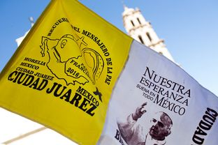 Memorabilia of Pope Francis is sold in the center of town steps from the Cathedral on Monday, February 15, 2016, in Juarez, Chihuhahua .