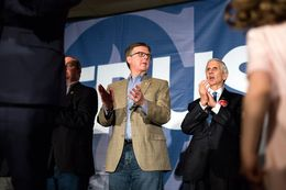 Texas Lieutenant Gov. Dan Patrick claps while Senator Ted Cruz speaking during his event in Columbia following  the Republican presidential primary, Saturday night, February 20, 2016.
