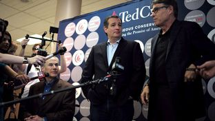 Ted Cruz, flanked by Gov. Greg Abbott and former Governor Rick Perry, campaigns in San Antonio a day ahead of Super Tuesday, Feb 29, 2016.