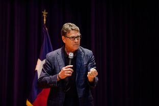 Former Gov. Rick Perry campaigns for Ted Cruz in San Antonio a day ahead of Super Tuesday, Feb 29, 2016.
