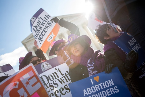 Lara Chelian, center, and her mother, Renee Chelian, both abortion providers from Michigan, hold signs in front of the U.S. Supreme Court in Washington, D.C., as Whole Woman's Health v. Hellerstedt is argued inside on March 2, 2016. The case is focused on the Texas law known as House Bill 2.