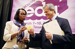 Mayor of San Antonio Ivy Taylor gifts the mayor of Austin Steve Adler a taco stress toy at the conclusion of the Taco Summit held at the Hilton Austin on March 10, 2016.