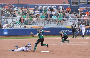 Bailee Baldwin of the University of Texas at San Antonio's softball team slid into second base as Kelli Schkade of the University of North Texas covered second during a recent game on March 12, 2016, in San Antonio.