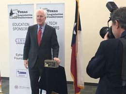 "U.S. Sen. John Cornyn, R-Texas, with the ""Texan of the Year"" award at the Texas Legislative Conference in New Braunfels on March 18, 2016."