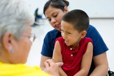 Nicholas Nunez, 4, sits with his mother, Elizabeth Trejo, while he receives his shots at the Immunization Collaboration of Tarrant County in Fort Worth on August 30, 2013.