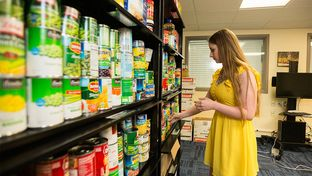 Ashlee Taylor, president of the graduate student advisory council and a Ph.D. student in nutritional sciences at Texas Tech University, organizes the Wreck Hunger graduate and international student food pantry on April 18, 2016.