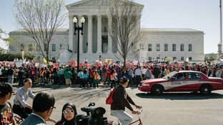Hundreds gathered in front of the U.S. Supreme Court to show their support for President Obama's immigration executive action as the Court hears oral arguments on the action in Washington, D.C., on April 18, 2016.