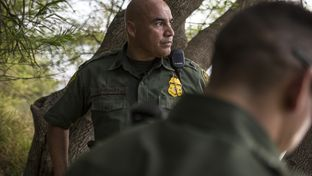 Border Patrol Agent José Perales peers out across the Rio Grande in Roma, Texas, while searching for a group of five undocumented immigrants reported to have crossed the river in a raft from Ciudad Miguel Alemán, Mexico, on March 8, 2016.