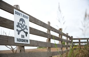 A sign protesting a proposed drilling waste dump near the South Texas town of Nordheim is shown in 2014. The Texas Railroad Commission, charged with only evaluating groundwater effects, approved the waste site plan on May 3, 2016.