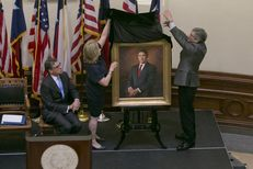 Former Texas First Lady Anita Perry and artist James Tennison unveil the official portrait of the 47th governor of Texas, Rick Perry, on May 6, 2016.