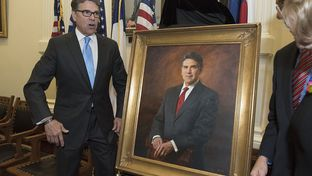 Former Texas Gov. Rick Perry posed with his official portrait before its hanging at the Texas Capitol on May 6, 2016.