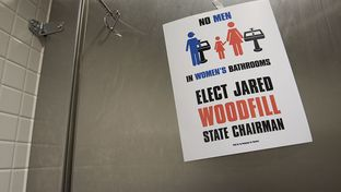 A sticker in the women's restroom at the Dallas Convention Center placed by the Jared Woodfill campaign on May 12, 2016