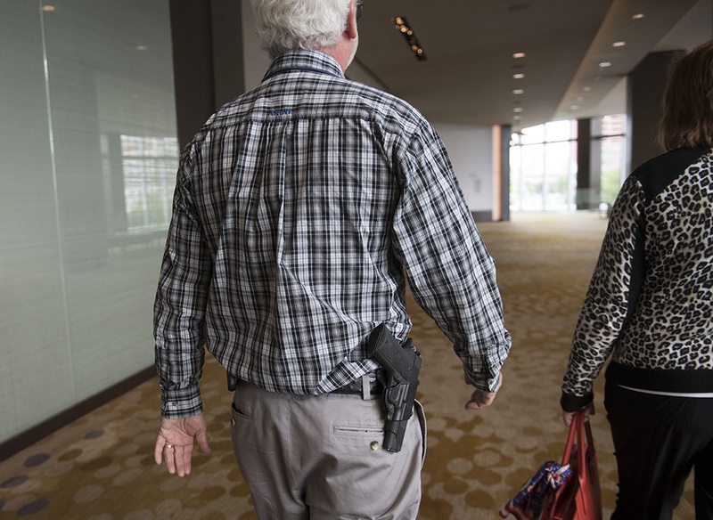 Delegate James Blair of Cherokee County open carries a firearm while leaving the Dallas Convention Center at the Republican Party of Texas gathering on May 14, 2016.