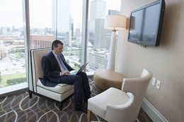 U.S. Sen. Ted Cruz sits by himself in a hotel suite as he prepares for his keynote speech to Republican delegates in Dallas May 14, 2016.