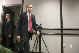 Texas Attorney General Ken Paxton, enters room where he will announce information on a lawsuit filed in U.S District Court against several federal agencies regarding bathroom and locker room rules in Texas public schools on May 25, 2016