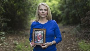 LaNelia Ramette holds a portrait of her son Michael in a Coppell park on May 21, 2016. Ramette lost her son to suicide in 2010 and now helps families dealing with the suicide of a loved one.