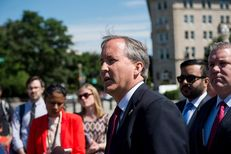 Texas Attorney General Ken Paxton holds a press conference on June 9, 2016 in front of the U.S. Supreme Court to discuss the filing of a lawsuit against the state of Delaware